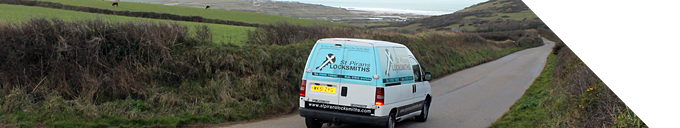 Photograph of St Piran's Locksmiths' van travelling on the B3301 coast road between Portreath and Hayle.