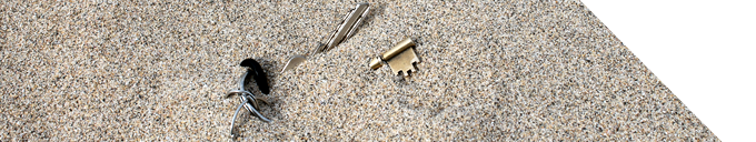 A picture of some keys partially buried on a Cornish beach.
